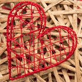 Red heart shaped ornamental box on wicker