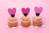 Three valentines cupcakes with heart decorations