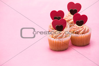 Four valentines cupcakes with heart decorations