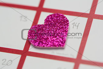 Close up of pink glittery heart marking valentines day
