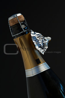 Top of bottle of champagne with ripped foil