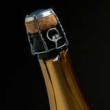 Zoom on top of champagne bottle