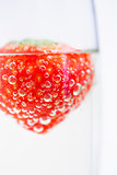 Strawberry floating in champagne