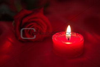 Candle with red rose