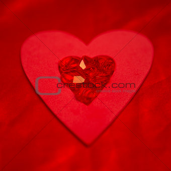Rubies resting on red heart