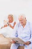 Elderly couple reading on the bed