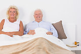 Old couple lying on the bed