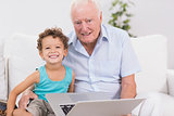 Grandfather and grandson with a laptop