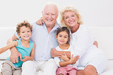 Cheerful grandparents with children