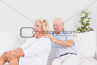 Old man massing a elderly woman
