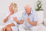 Elderly couple quarrelling