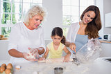 Multigeneration family women baking together