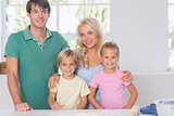 Smiling family baking