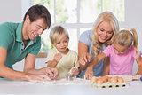 Family cutting the dough