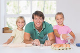 Smiling family with baking tools