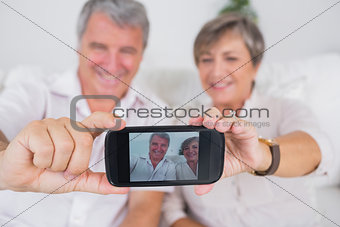 Old lovers taking a picture of themselves