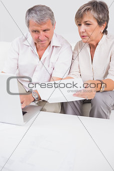 Old lovers not understanding the accounts and using laptop