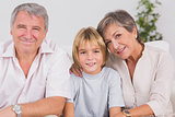 Portrait of a little boy and his grandparents smiling