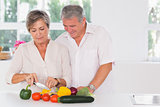 Old couple preparing vegetables