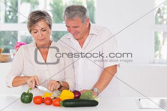 Old couple preparing vegetables