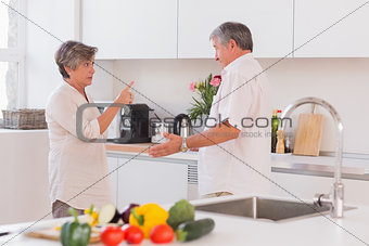 Old couple yelling in the kitchen