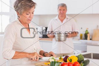 Old couple preparing food