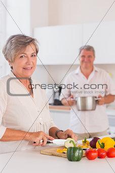 Old lovers preparing food
