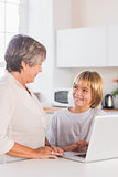 Granny and grandson using laptop