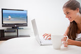 Woman with a cup surfing the internet