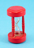 broken red sand glass clock on blue background