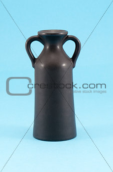 old ceramic vase with two handle blue background