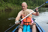 Dad and little daughter are sailing, kayaking on the river.