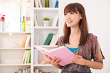 chinese girl reading on sofa lifestyle photo chinese girl readin