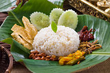 nasi lemak, a traditional malay curry paste rice dish served on