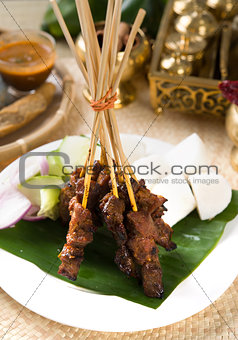 Asian Cuisine beef Satay with rice and traditional setup