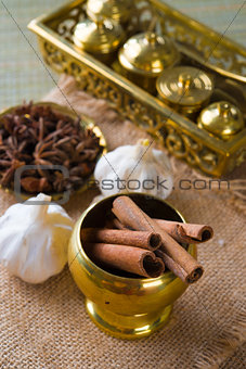 Cinnamon sticks and indian spices with traditional setup decorat