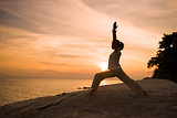 silhouette girl posing yoga on beautiful beach during sunset