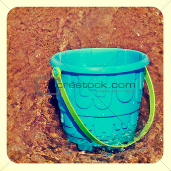 beach pail in the sea