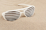 funny sun glasses in sand
