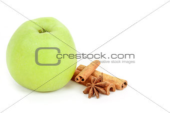 green apple and spices isolated on a white background