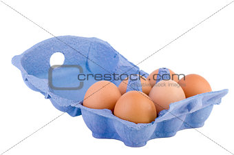 Cardboard egg box with six brown eggs