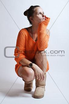 beautiful woman in orange sweater