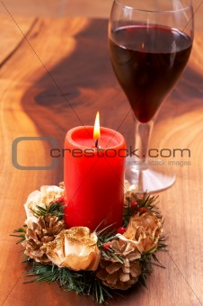 Christmas candle and a glass of wine