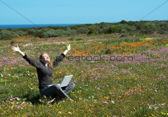 Blonde woman in the field of flowers