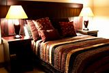 Colorful cushions on the bed