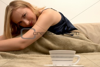 Blonde woman sitting on the bed