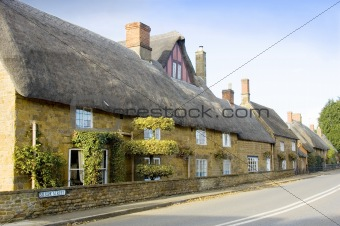 Row of houses with thatched rooves