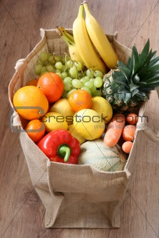 Assortment of fruit and vegetable in ecological bag