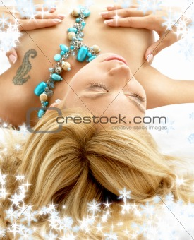 dreaming blond in bed with snowflakes