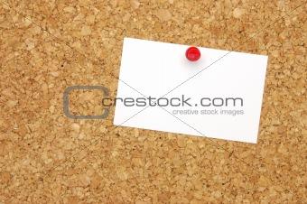 Blank business card on corkboard